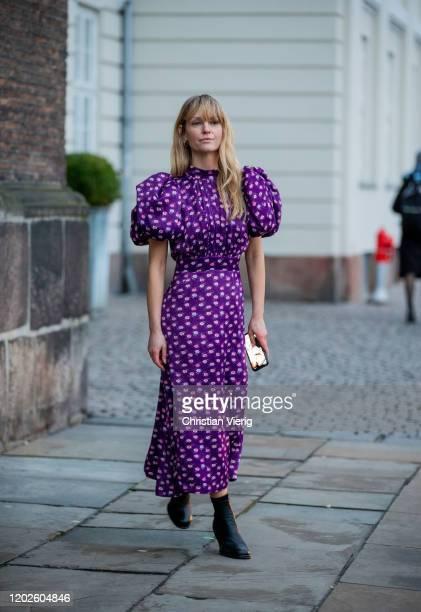 Jeanette Friis Madsen seen wearing purple dress outside Lovechild on Day 1 during Copenhagen Fashion Week Autumn/Winter 2020 on January 28, 2020 in...