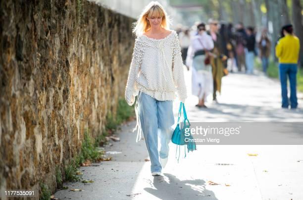 Jeanette Friis Madsen seen wearing white knt, denim jeans, turqouis Loewe bag outside Loewe during Paris Fashion Week Womenswear Spring Summer 2020...