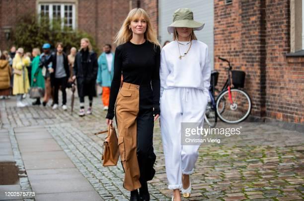 Jeanette Friis Madsen wearing beige black two tone pants brown Hermes bag and Thora Valdimars wearing flat cap white jogger pants jumper heels seen...