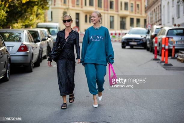 Jeanette Friis Madsen wearing black dress and Thora Valdimars wearing Rotate sweater and jogger pants is seen outside By Malene Birger during...