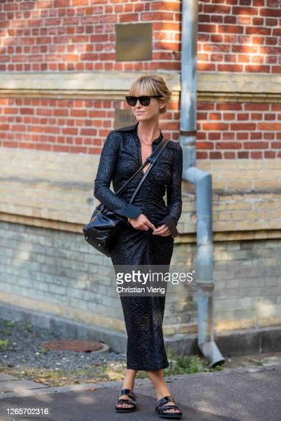 Jeanette Friis Madsen wearing black dress is seen outside By Malene Birger during Copenhagen Fashion Week Spring/Summer 2021 on August 12, 2020 in...