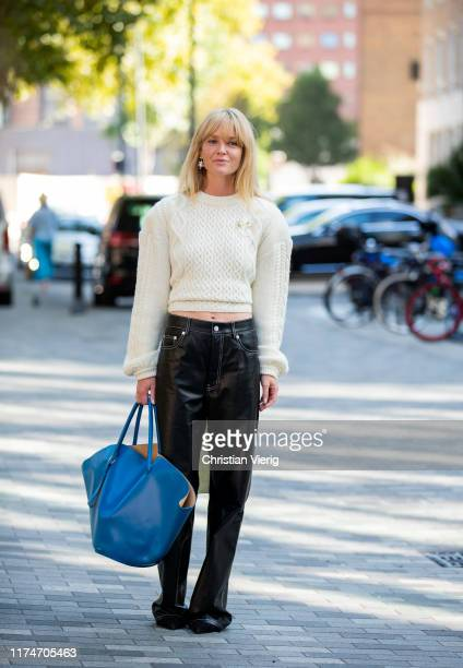 Jeanette Friis Madsen wearing creme white knit black leather pants blue oversized triangle bag seen outside Ports 1961 during London Fashion Week...