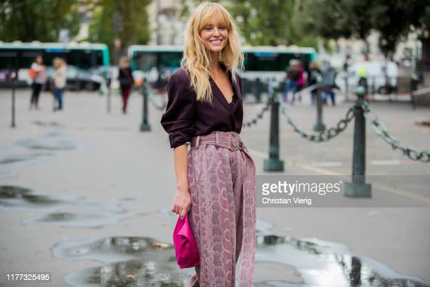 Jeanette Friis Madsen wearing high waist pants with print bordeaux top outside Redemption during Paris Fashion Week Womenswear Spring Summer 2020 on...