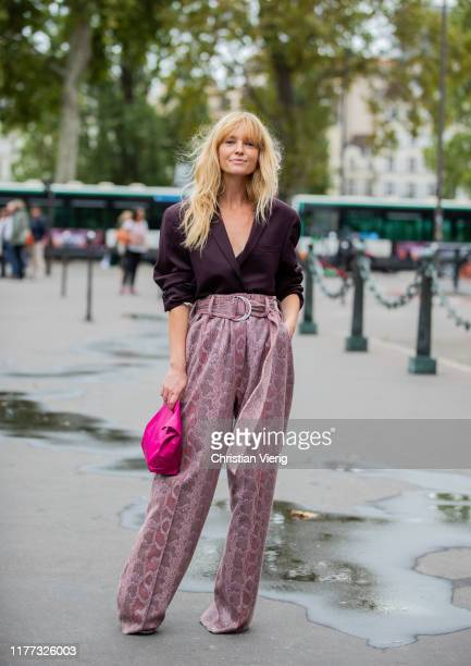 Jeanette Friis Madsen wearing high waist pants with print, bordeaux top outside Redemption during Paris Fashion Week Womenswear Spring Summer 2020 on...