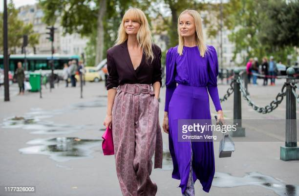 Jeanette Friis Madsen wearing high waist pants with print bordeaux top Thora Valdimars is seen wearing purple dress with slit pants with print...