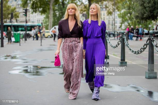 Jeanette Friis Madsen wearing high waist pants with print bordeaux top and Thora Valdimars is seen wearing purple dress with slit pants with print...