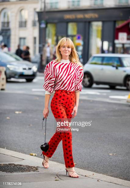 Jeanette Friis Madsen wearing red white striped knit red pants with print outside Beautiful People during Paris Fashion Week Womenswear Spring Summer...