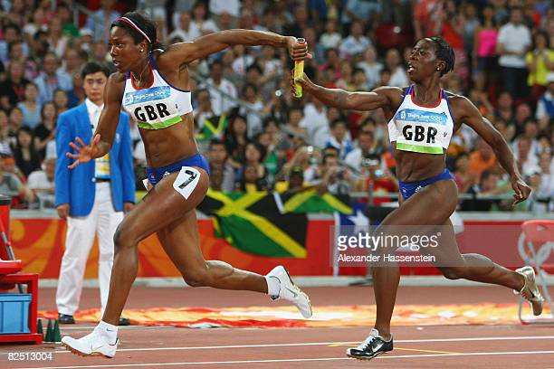 Jeanette Kwakye of Great Britain hands over the baton to Montell Douglas as they compete in the Women's 4 x 100m Relay Final at the National Stadium...