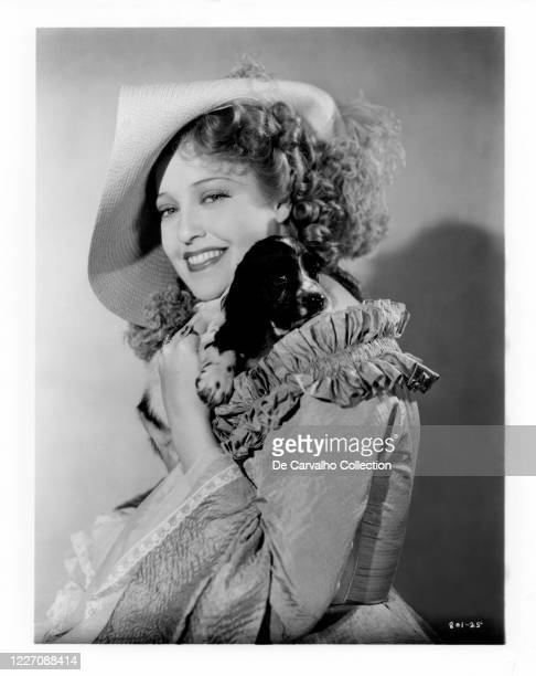 Jeanette MacDonald as 'Marietta' holding a puppy of Cocker Spaniel in a publicity shot from the movie 'Naughty Marietta' United States