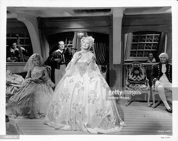 Jeanette MacDonald is the center of attention in the scene from the film 'New Moon' 1940