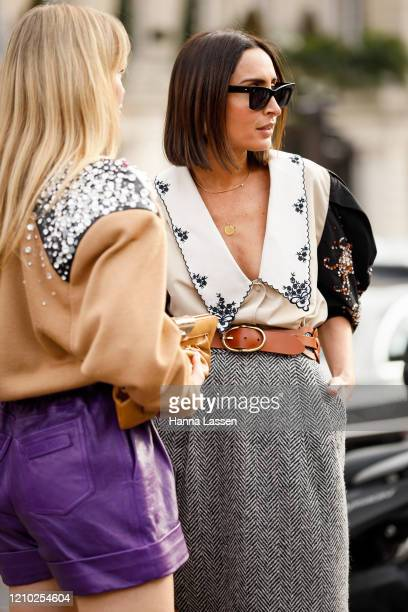 Jeanette Madsen and Geraldine Boublil wearing Miu Miu embroidery blouse and beaded cardigan outside the Miu Miu show during Paris Fashion Week...