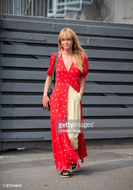 Jeanette Madsen is seen wearing red button up dress beige pants outside Munthe during Copenhagen Fashion Week Spring/Summer 2020 on August 07 2019 in...