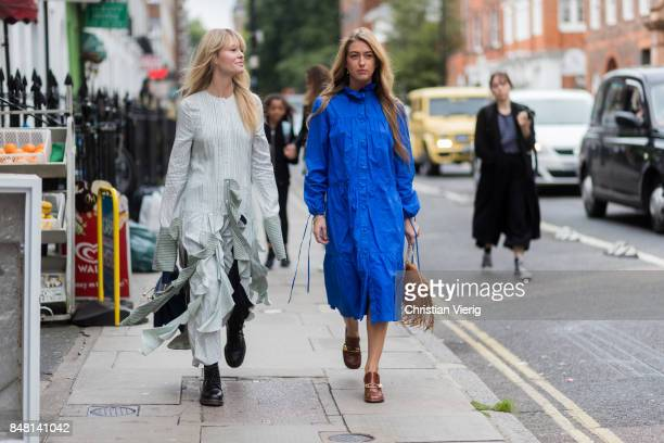 Jeanette Madsen wearing a ruffled dress and Emili Sindlev wearing a brown JW Anderson bag with fringes blue dress outside JW Anderson during London...