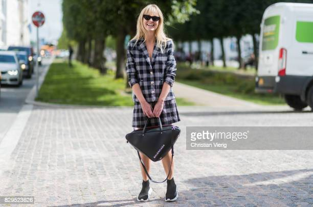 Jeanette Madsen wearing Balenciaga bag outside Baum Und Pferdgarten on August 10 2017 in Copenhagen Denmark