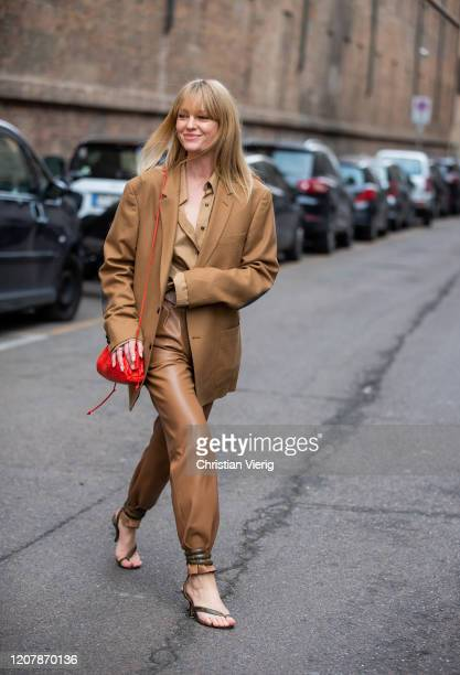 Jeanette Madsen wearing brown suit, red bag seen outside Sportmax during Milan Fashion Week Fall/Winter 2020-2021 on February 21, 2020 in Milan,...