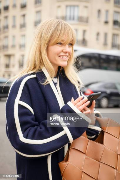Jeanette Madsen wearing Loewe navy with with trimmed coat brown Bottega Veneta bag and jeans outside the Loewe show during the Paris Fashion Week...