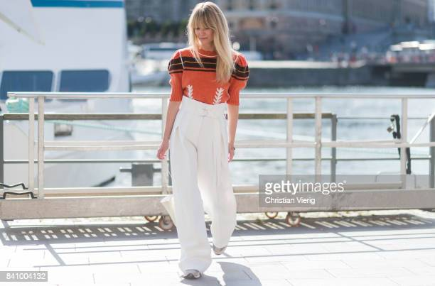 Jeanette Madsen wearing Miu Miu sweater white overall outside Whyred on August 30 2017 in Stockholm Sweden