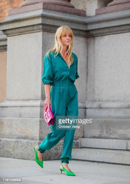 Jeanette Madsen wearing overall is seen outside Samsøe Samsøe during Copenhagen Fashion Week Spring/Summer 2020 on August 07 2019 in Copenhagen...