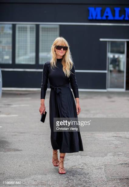 Jeanette Madsen wearing Rotate dress is seen outside By Malene Birger during Copenhagen Fashion Week Spring/Summer 2020 on August 08, 2019 in...