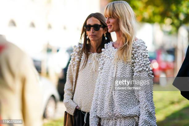 Jeanette Madsen wears a beaded pullover with attached shiny pearls, outside Loewe, during Paris Fashion Week - Womenswear Spring Summer 2020, on...