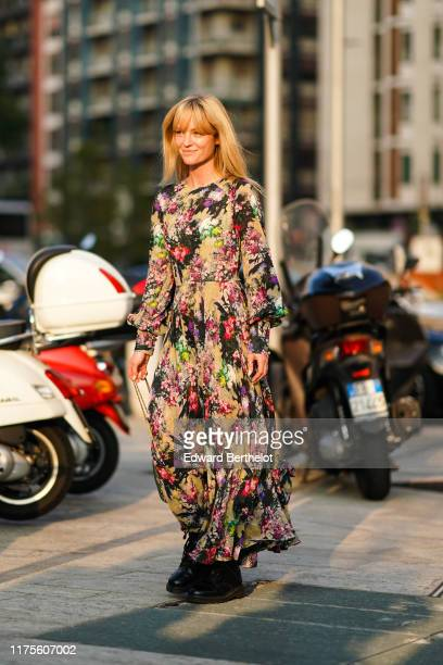Jeanette Madsen wears a colored floral print dress, outside the Alberta Ferretti show during Milan Fashion Week Spring/Summer 2020 on September 18,...