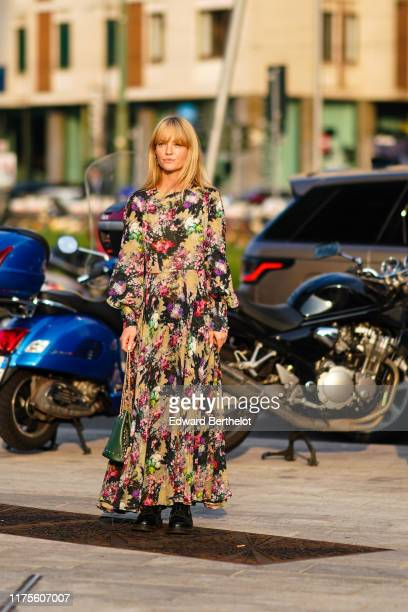Jeanette Madsen wears a colored floral print dress outside the Alberta Ferretti show during Milan Fashion Week Spring/Summer 2020 on September 18...