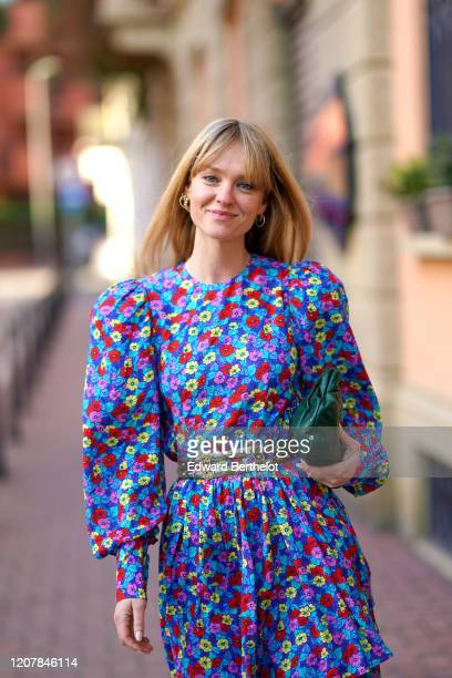 Jeanette Madsen wears a multicolor floral print dress, a green bag, outside Marni, during Milan Fashion Week Fall/Winter 2020-2021 on February 21,...