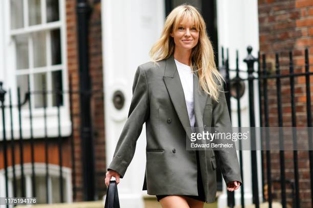 Jeanette Madsen wears an oversized blazer jacket with rolled-up sleeves, during London Fashion Week September 2019 on September 16, 2019 in London,...