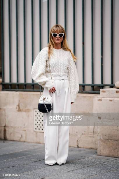 Jeanette Madsen wears sunglasses a white wool pullover flared pants a Chanel bag outside Paul Joe during Paris Fashion Week Womenswear Fall/Winter...