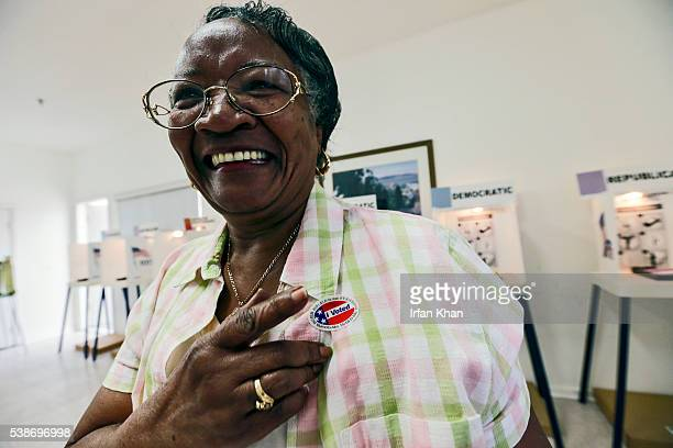 Jeanette Owens gets a I voted sticker after casting her ballot in California primary elections on Tuesday morning June 07 at Curry Temple Christian...