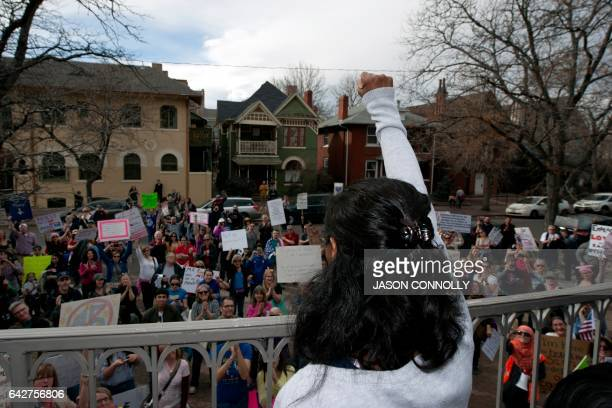 Jeanette Vizguerra an undocumented Mexican mother of three US born children holds her fist up high when talking to supporters gathered outside the...