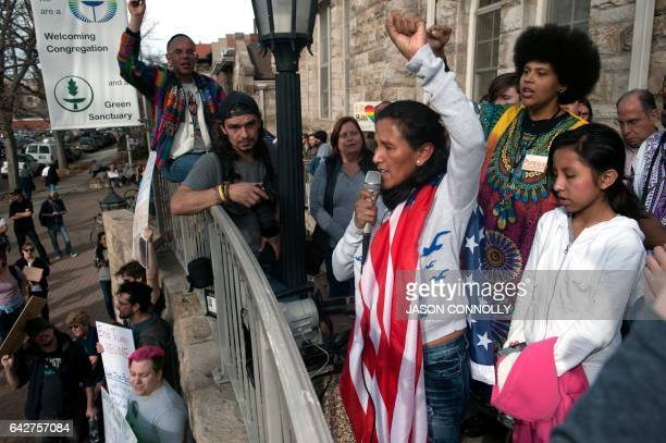 Jeanette Vizguerra an undocumented Mexican mother of three US born children holds her fist up high as as she addresses supporters gathered outside...