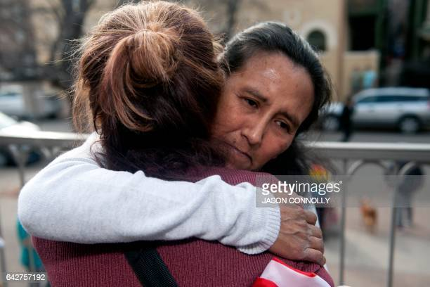 Jeanette Vizguerra an undocumented Mexican mother of three US born children embraces a supporter after speaking to the gathered crowd outside the...