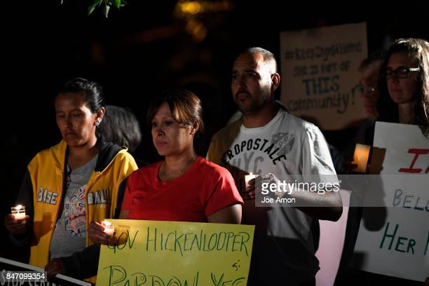 Jeanette Vizguerra Ana Sauzameda and her husband Arturo Hernandez Garcia stand with Ingrid Encalada Latorre and her supporters during a candle light...