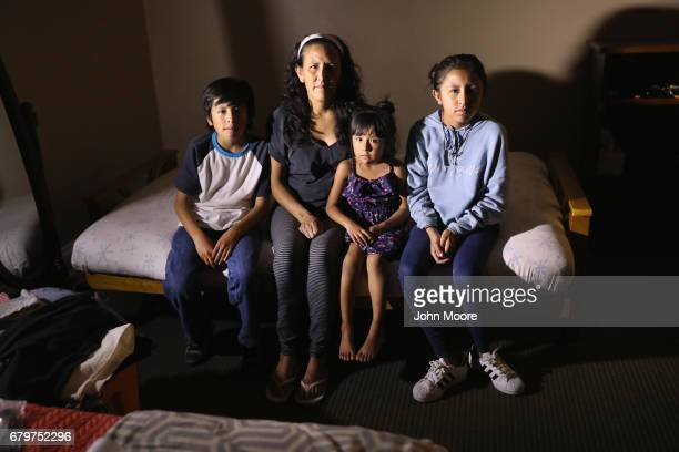 Jeanette Vizguerra sits with her USborn children Roberto Zury and Luna 12 while taking sanctuary at the First Baptist Church on May 5 2017 in Denver...