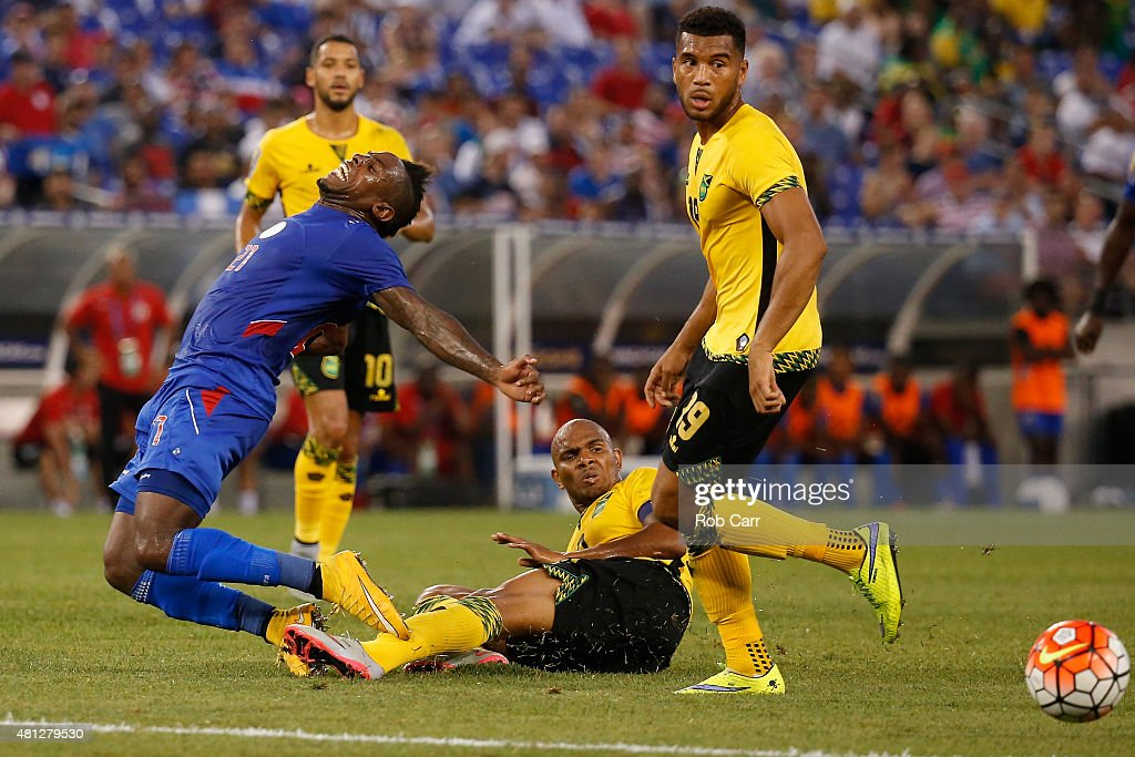 Jean-Eudes Maurice #21 of Haiti tangles with Rodolph Austin #17 of Jamaica during the second half of the 2015 CONCACAF Gold Cup quarterfinal match at M&T Bank Stadium on July 18, 2015 in Baltimore, Maryland.