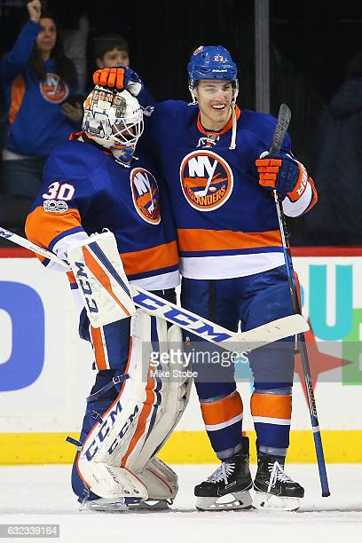 JeanFrancois Berube and Anders Lee of the New York Islanders celebrate after defeating the Los Angeles Kings 42 at the Barclays Center on January 21...