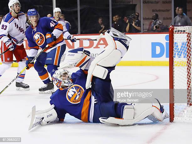 JeanFrancois Berube of the New York Islanders can't stop a third period shot by Nicklas Jensen of the New York Rangers at the Barclays Center on...