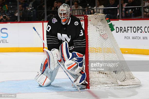 JeanFrancois Berube of the New York Islanders defends against the Minnesota Wild during the game at the Barclays Center on February 2 2016 in...