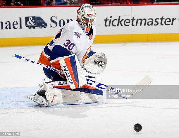 JeanFrancois Berube of the New York Islanders deflects the puck out of the crease during an NHL game against the Carolina Hurricanes at PNC Arena on...