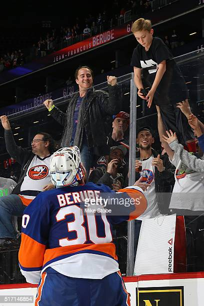 JeanFrancois Berube of the New York Islanders gives a young fan a puck after recieving the first star of the game at the Barclays Center on March 23...