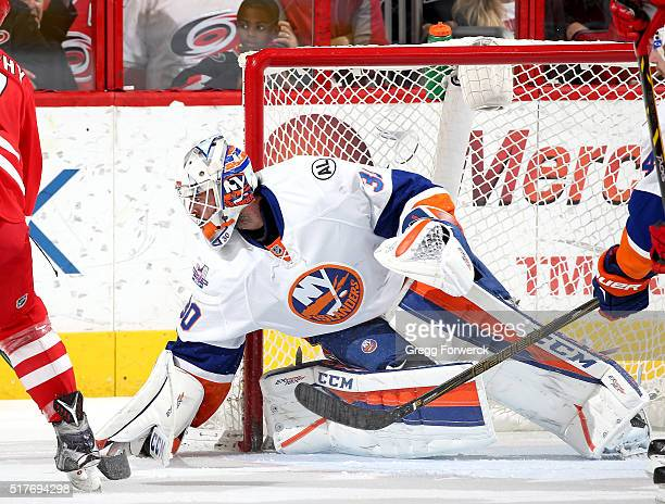 JeanFrancois Berube of the New York Islanders makes a pad save during an NHL game against the Carolina Hurricanes at PNC Arena on March 26 2016 in...