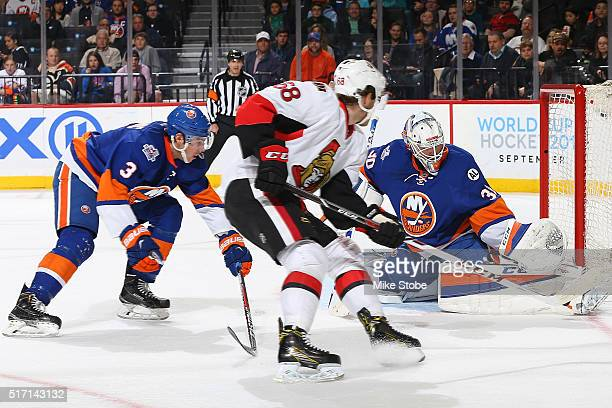 JeanFrancois Berube of the New York Islanders makes a save against Mike Hoffman of the Ottawa Senators at the Barclays Center on March 23 2016 in...