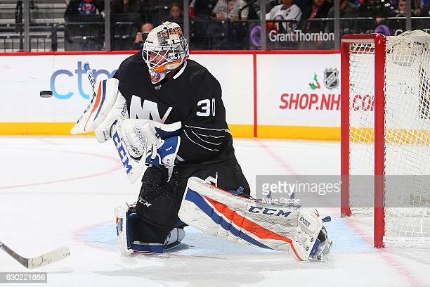 JeanFrancois Berube of the New York Islanders makes a save against the Ottawa Senators at the Barclays Center on December 18 2016 in Brooklyn borough...