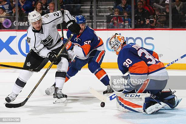 JeanFrancois Berube of the New York Islanders makes a save against Trevor Lewis of the Los Angeles Kings at the Barclays Center on January 21 2017 in...