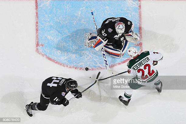 JeanFrancois Berube of the New York Islanders makes a save on Nino Niederreiter of the Minnesota Wild during the game at the Barclays Center on...