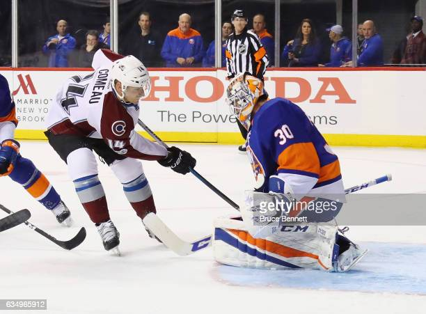 JeanFrancois Berube of the New York Islanders makes the first period stop on Blake Comeau of the Colorado Avalanche at the Barclays Center on...