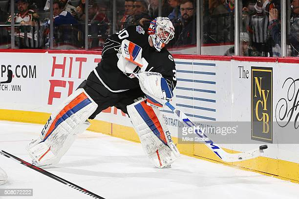 JeanFrancois Berube of the New York Islanders plays the puck during the game against the Minnesota Wild at the Barclays Center on February 2 2016 in...