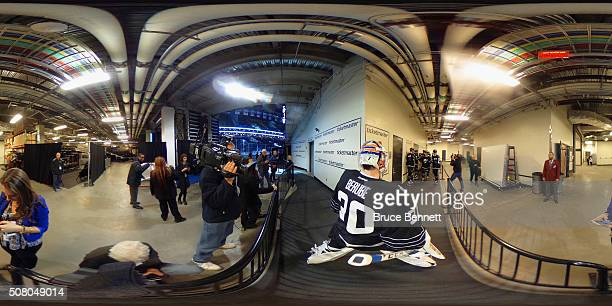JeanFrancois Berube of the New York Islanders prepares to lead the team out for warmups prior to the game against the Minnesota Wild at the Barclays...
