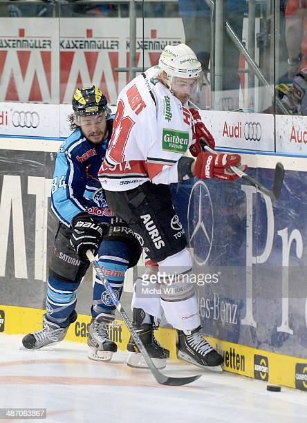 JeanFrancois Boucher of Ingolstadt and Torsten Ankert of Koeln battle for the puck in game six of the DEL final playoffs between ERC Ingolstadt and...